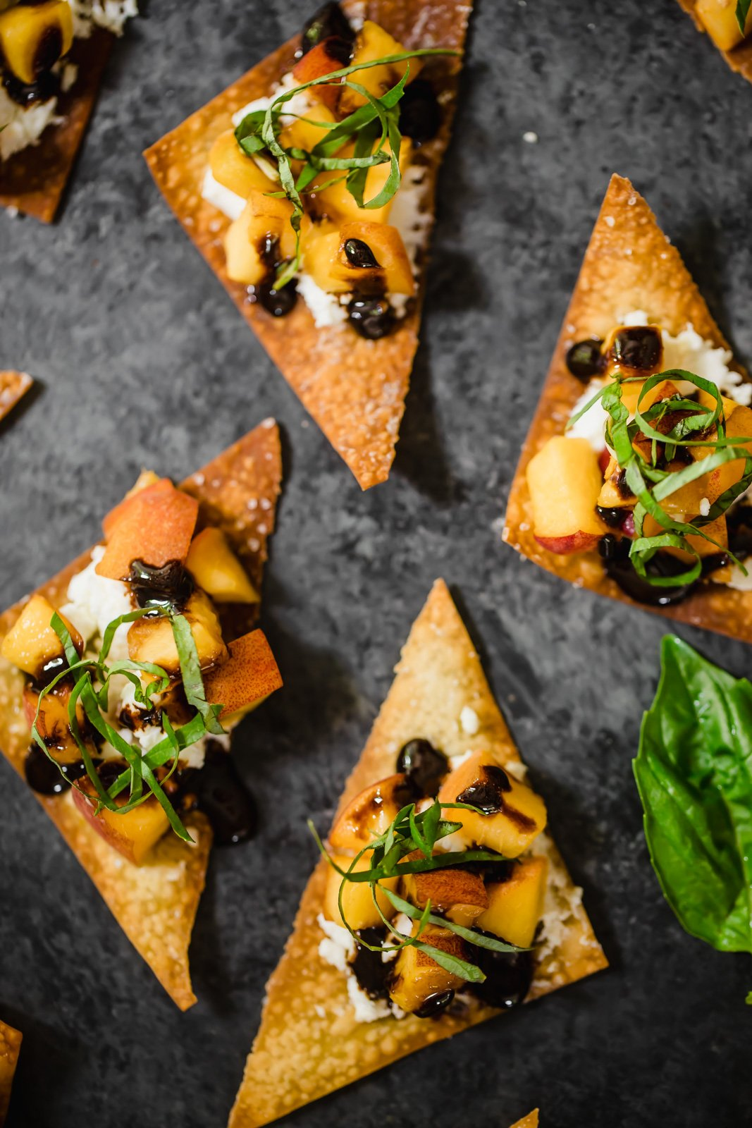 Juicy fresh peaches, creamy goat cheese and a balsamic reduction piled on a delicious baked wonton bites. The perfect summer appetizer ready in about 15 minutes!