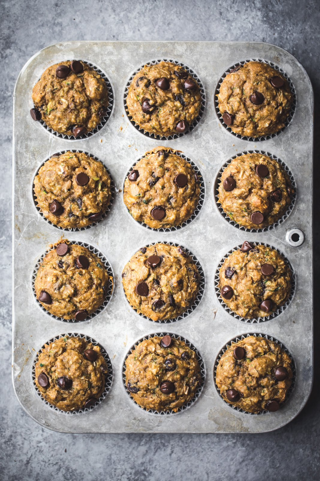 Healthy zucchini banana muffins in a muffin tin