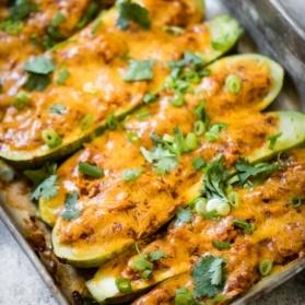 bbq chicken stuffed zucchini boats in a baking pan