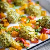 Sheet pan zucchini chicken meatballs baked with gorgeous roasted bell peppers and drizzled with a flavorful coconut curry sauce. This easy, incredibly delicious recipe is packed with protein and great for meal prep!