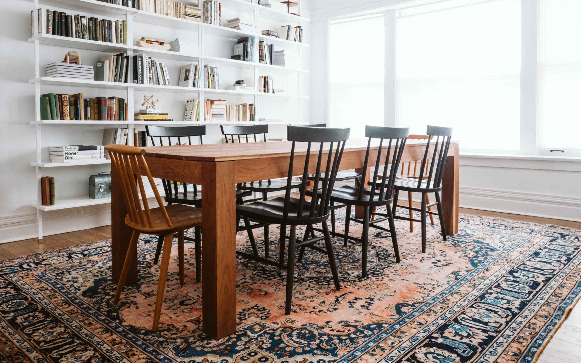 dining room with chairs on top of a large area rug