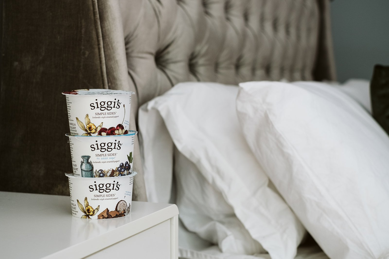three siggis cups in a stack on a bedside table
