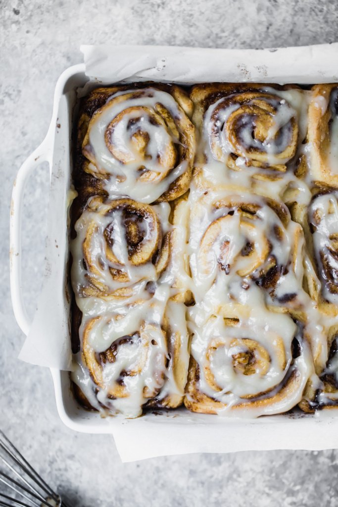 vegan banana bread cinnamon rolls in a square baking pan