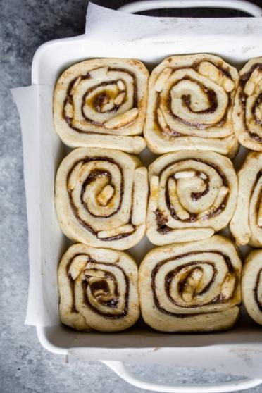 banana bread cinnamon rolls in a pan