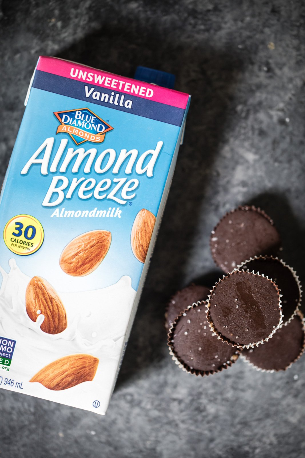 a carton of almond breeze almond milk next to vegan cookie dough cups
