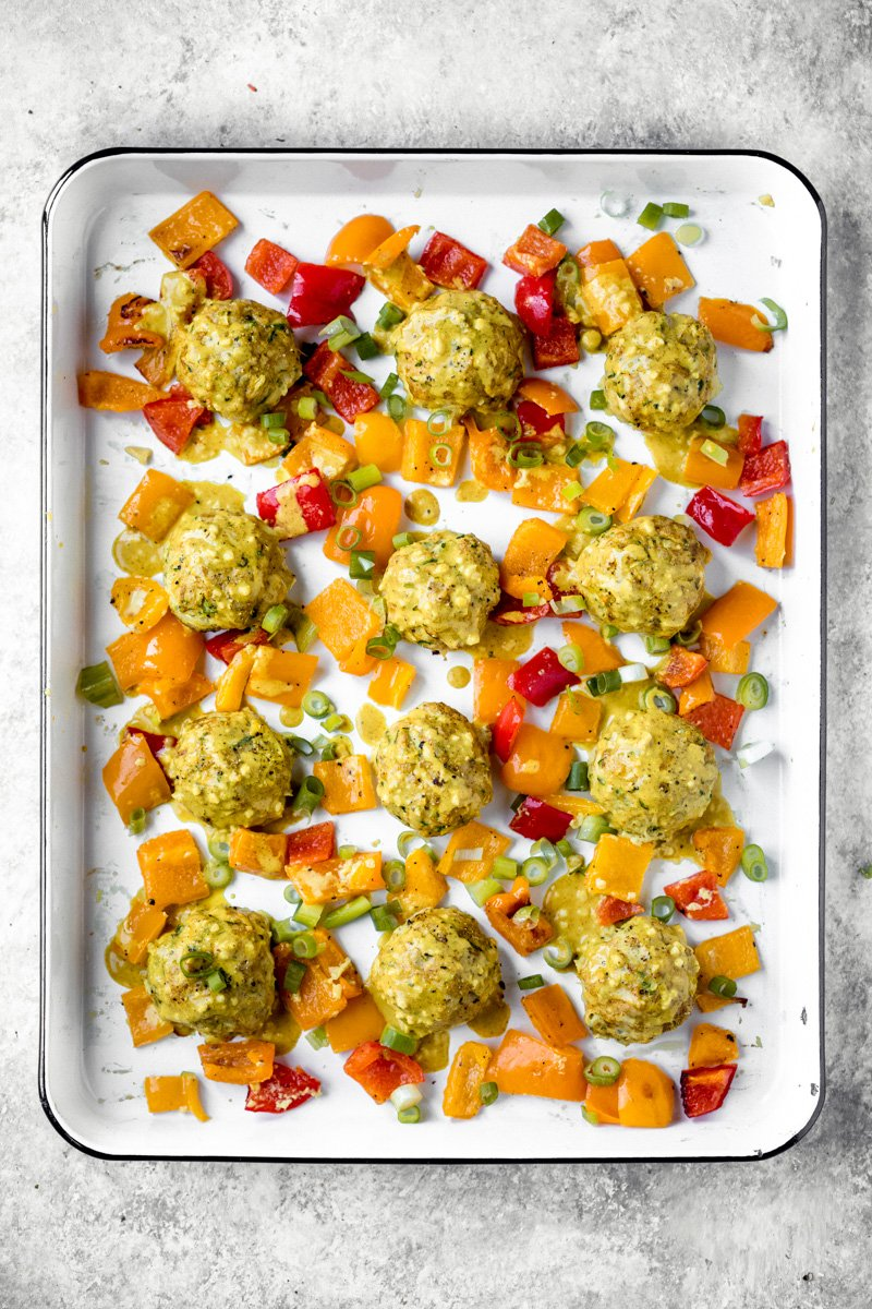 sheet pan zucchini chicken meatballs with orange and red bell peppers