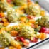 healthy chicken meatballs with coconut curry sauce and bell peppers
