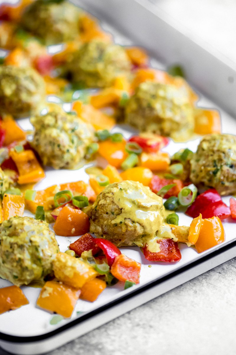 low carb chicken meatballs with coconut curry sauce and bell peppers