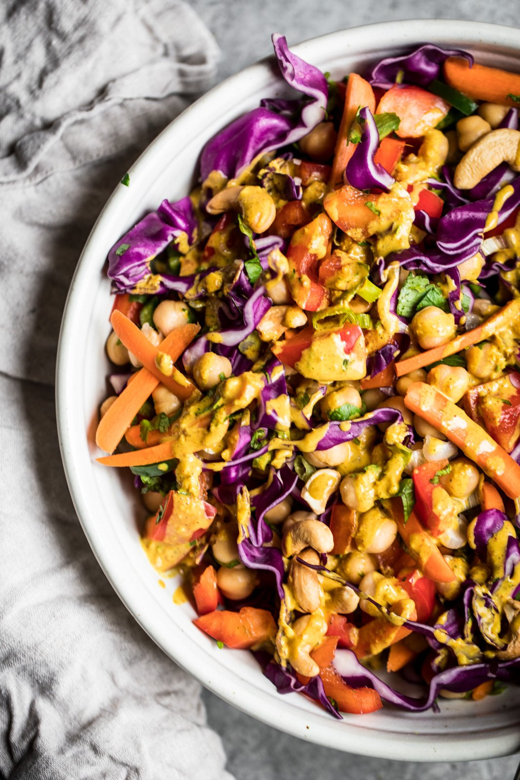 Beautiful plant based Chopped Thai Chickpea Salad with a super flavorful curry peanut dressing. Healthy, easy to make and a great way to get your veggies in!