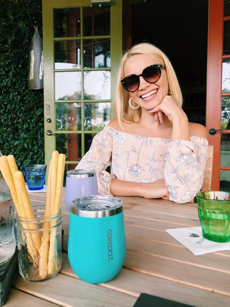 monique sitting at a table with wine tumblers