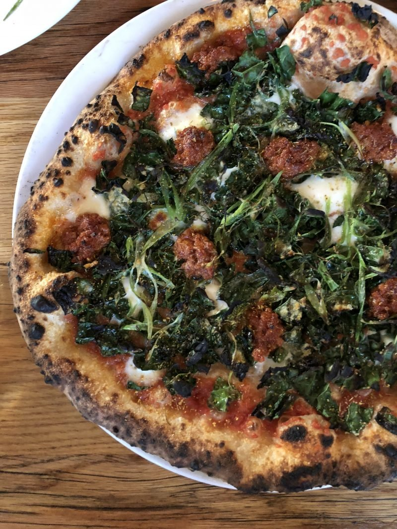 kale pizza on a plate