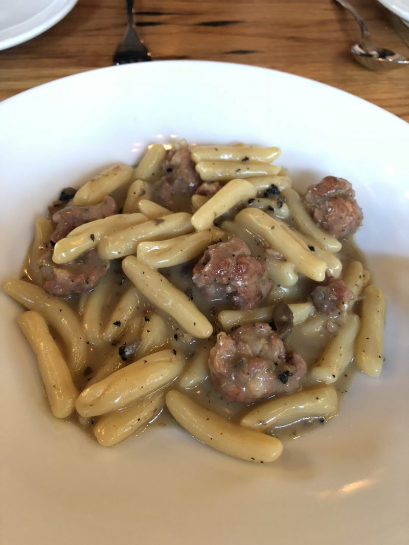 pasta with sausage pieces on a plate