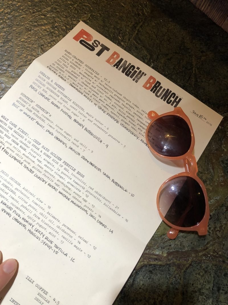 brunch menu with sunglasses on top
