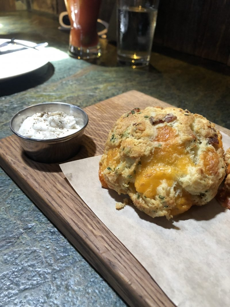 cheddar biscuit on a wooden board