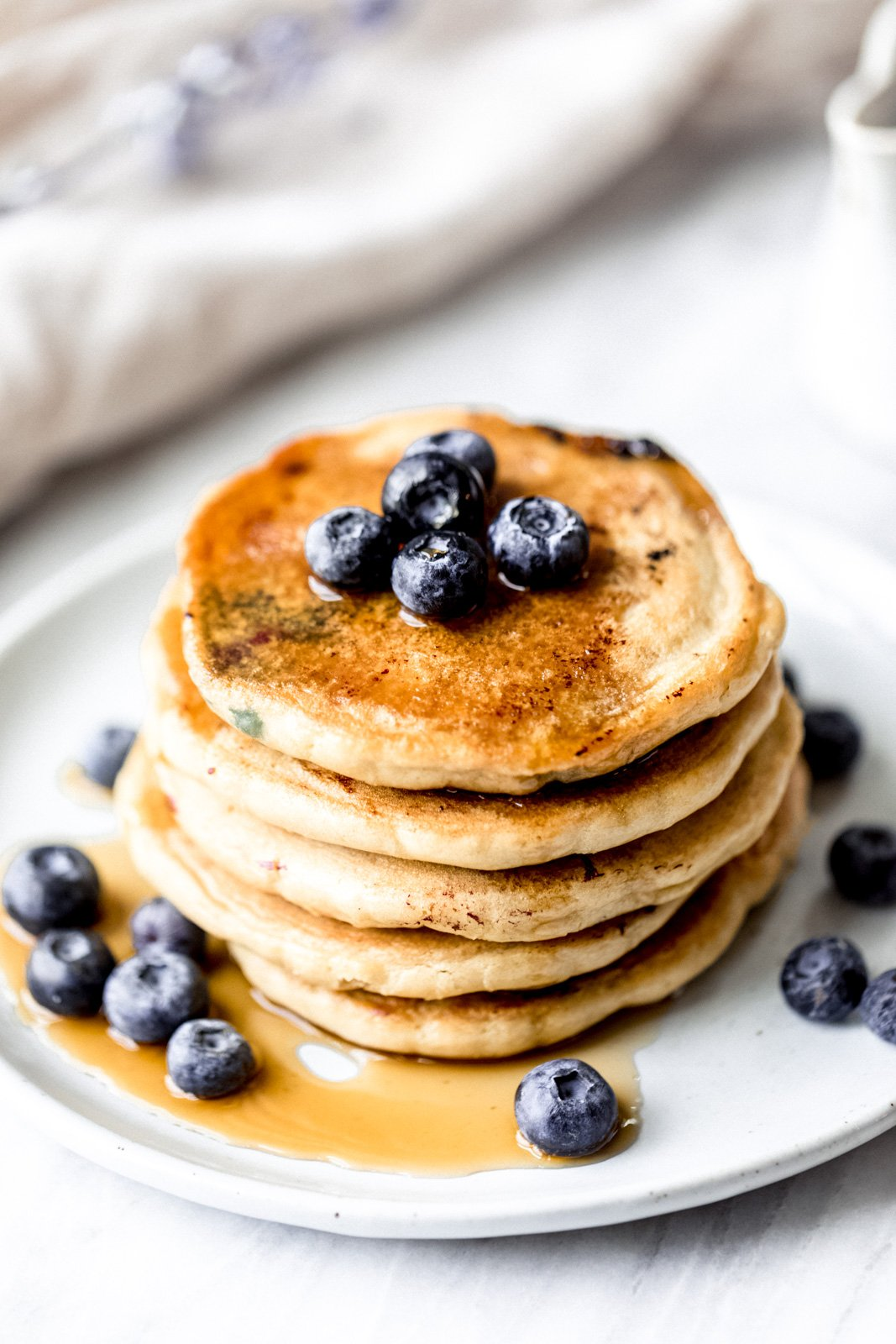 almond flour pancakes topped with blueberries on a plate