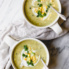 vegan corn chowder in two mugs with spoons