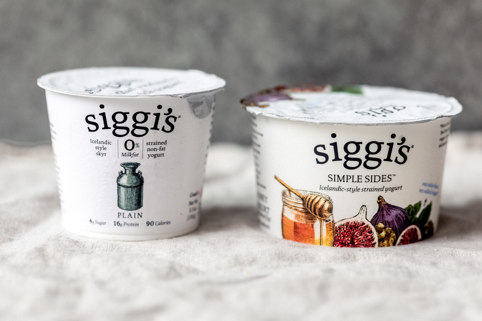 two containers of siggi's yogurt next to each other