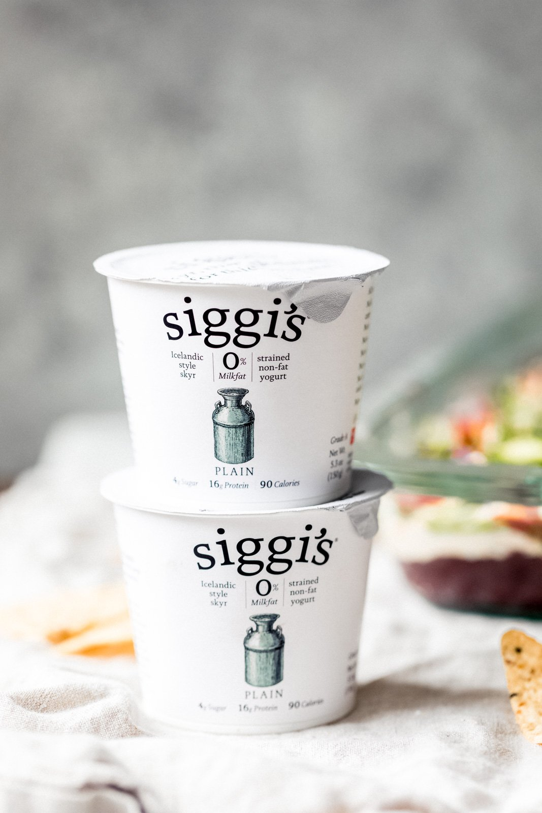 two containers of siggi's yogurt stack on top of each other