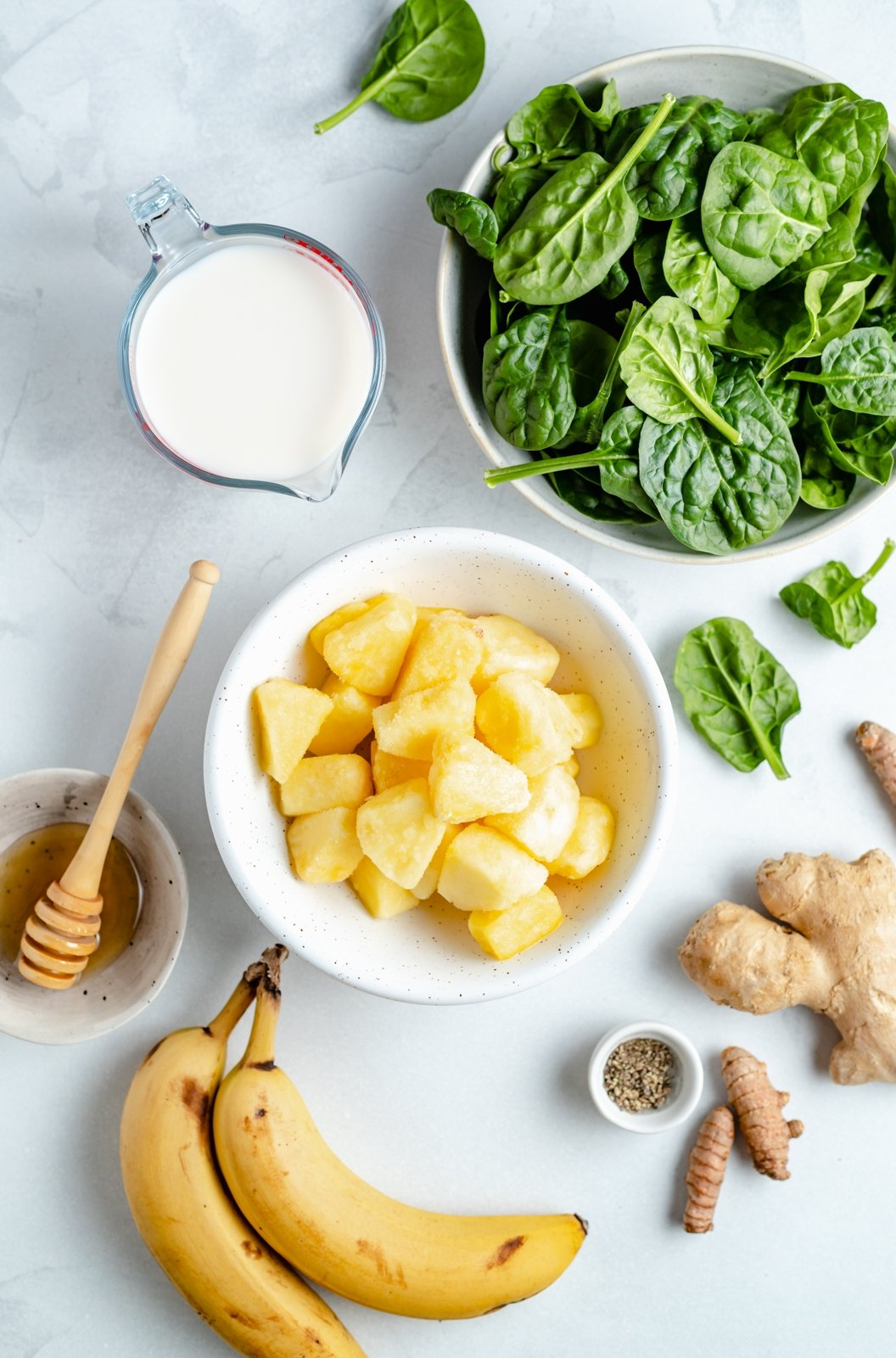 ingredients for an immune boosting wellness smoothie on a board