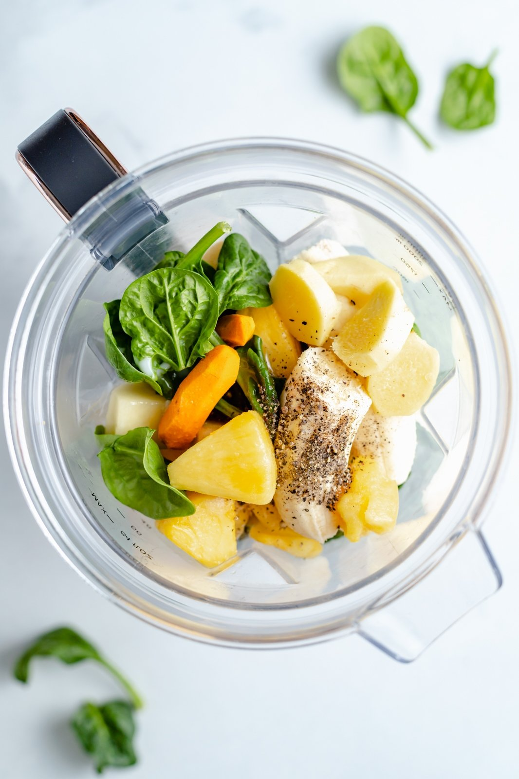 top-down view of ingredients for an immune boosting wellness drink in a blender