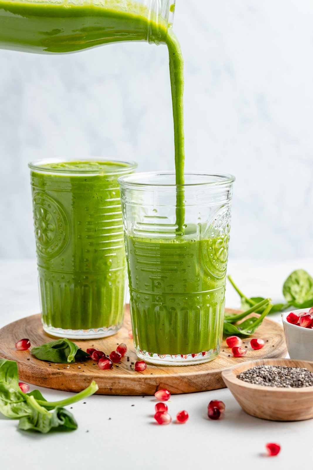 pouring an immune boosting smoothie into two glasses