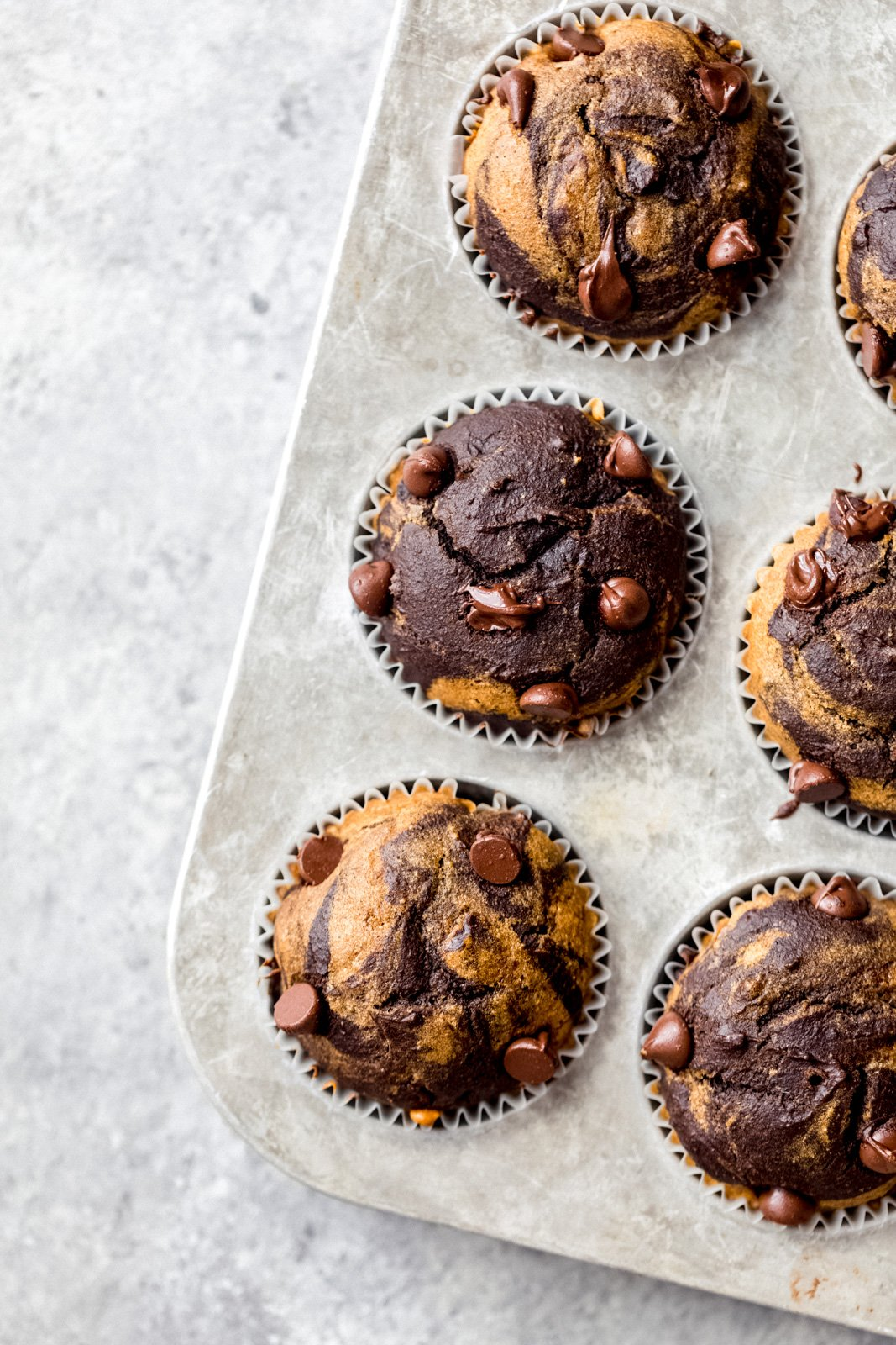 chocolate pumpkin muffins in a muffin tin
