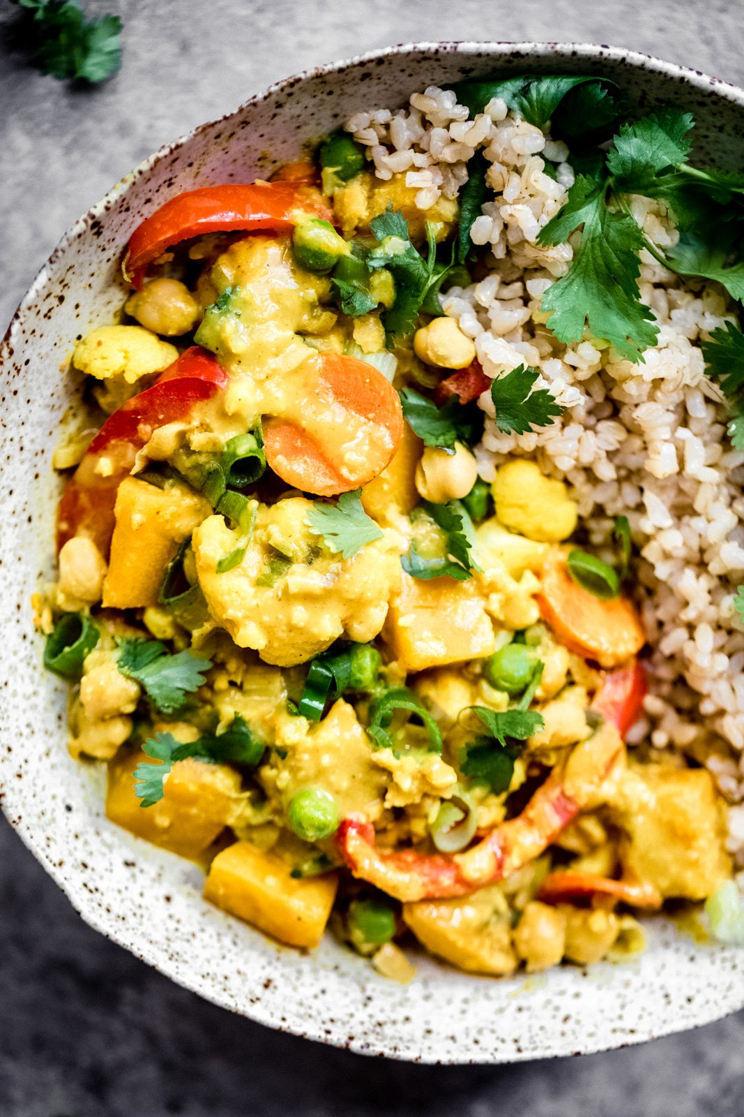 Nourishing yellow pumpkin chickpea curry simmered in cozy spices and served with fragrant coconut brown rice. This vegan curry recipe is packed with protein and perfect for meal prep!