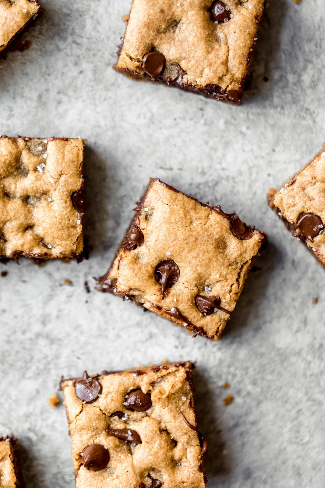 Paleo chocolate chip tahini blondies that are gooey with nutty, earthy notes and chocolate puddles in every bite. These will be your go-to dessert for parties, or whenever you need something sweet.
