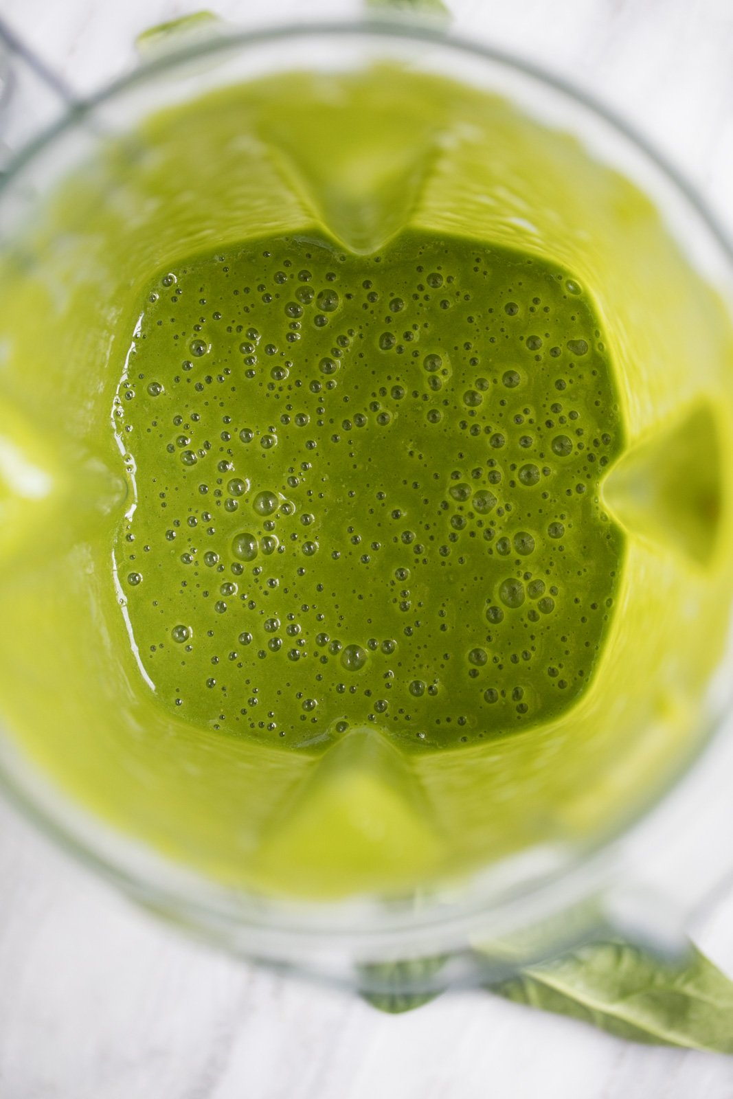 green wellness smoothie in a blender