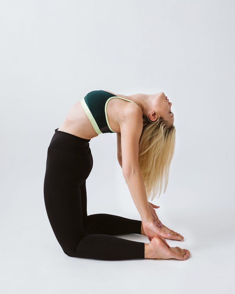 blonde woman doing a yoga pose