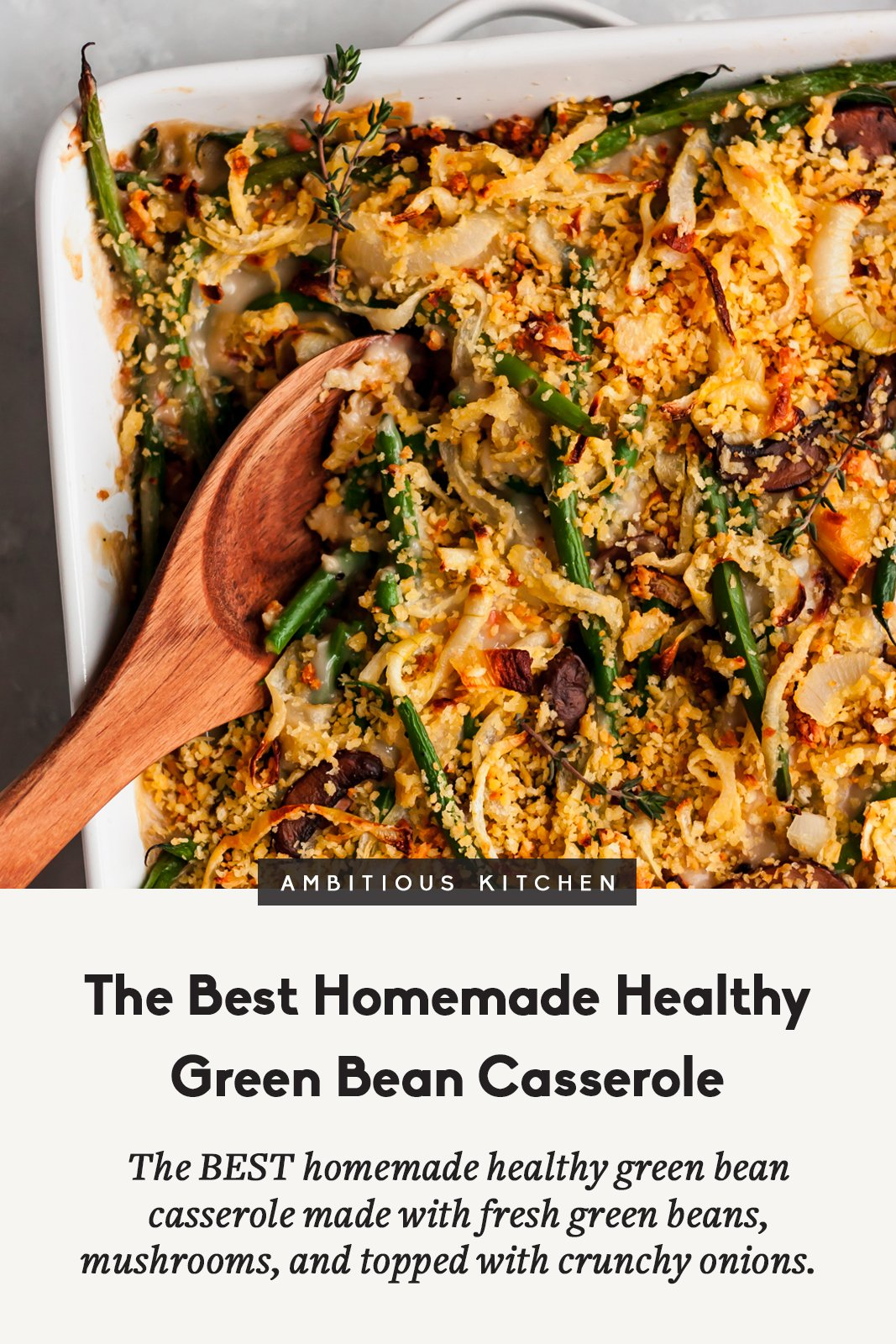 healthy green bean casserole in a baking dish with a wooden spoon and a title below it