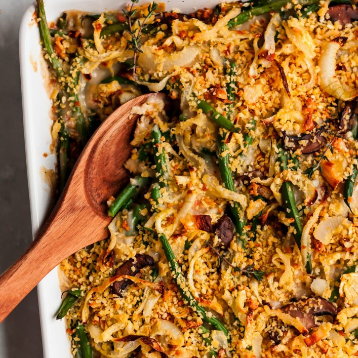 The BEST homemade healthy green bean casserole made with fresh green beans, mushrooms and topped with homemade crunchy onions. Lightened up from traditional versions and perfect for the holidays!