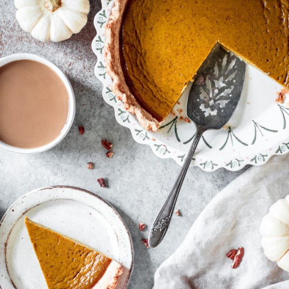 healthy pumpkin pie in a pie pan and on a plate