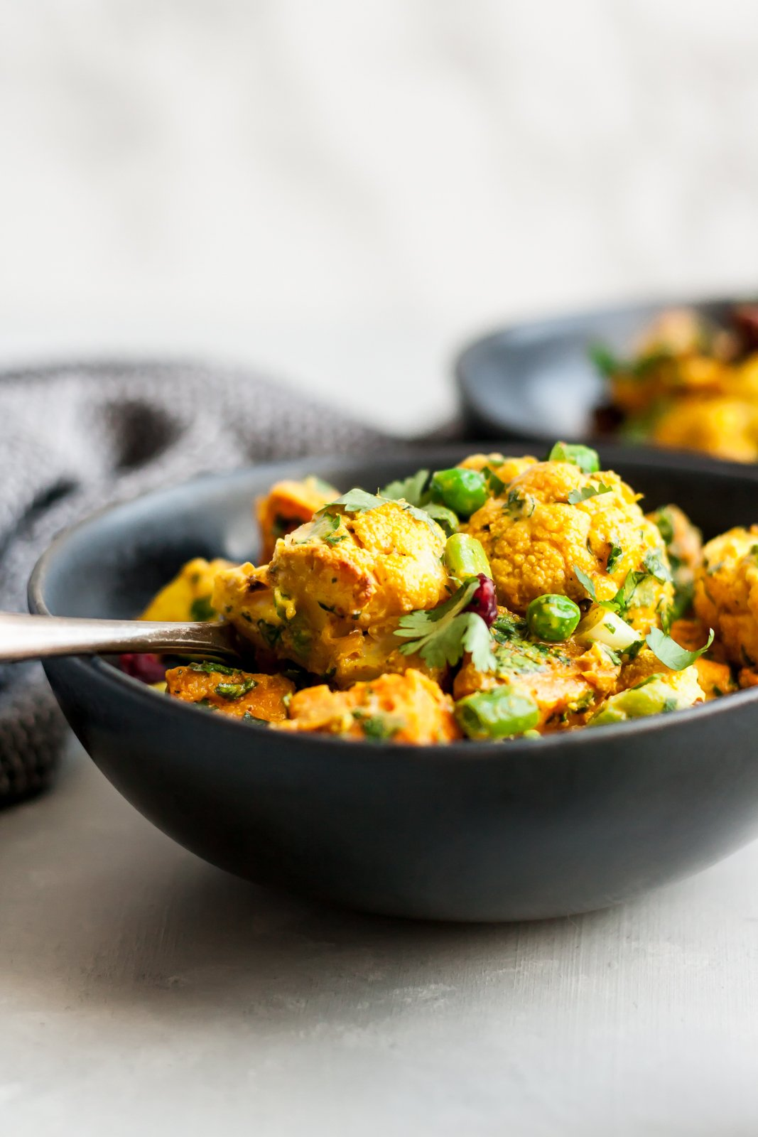 Vegan and gluten free curry roasted cauliflower sweet potato salad with a creamy curry tahini dressing. This salad is everything you could ever want. Easy to make, packed with veggies and absolutely addicting!