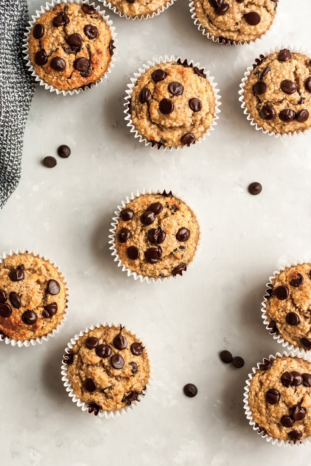 gluten free banana chocolate chip muffins on a grey board