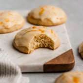 Italian iced orange cookies with icing on a marble board