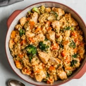 broccoli cheddar chicken couscous in a ceramic pot