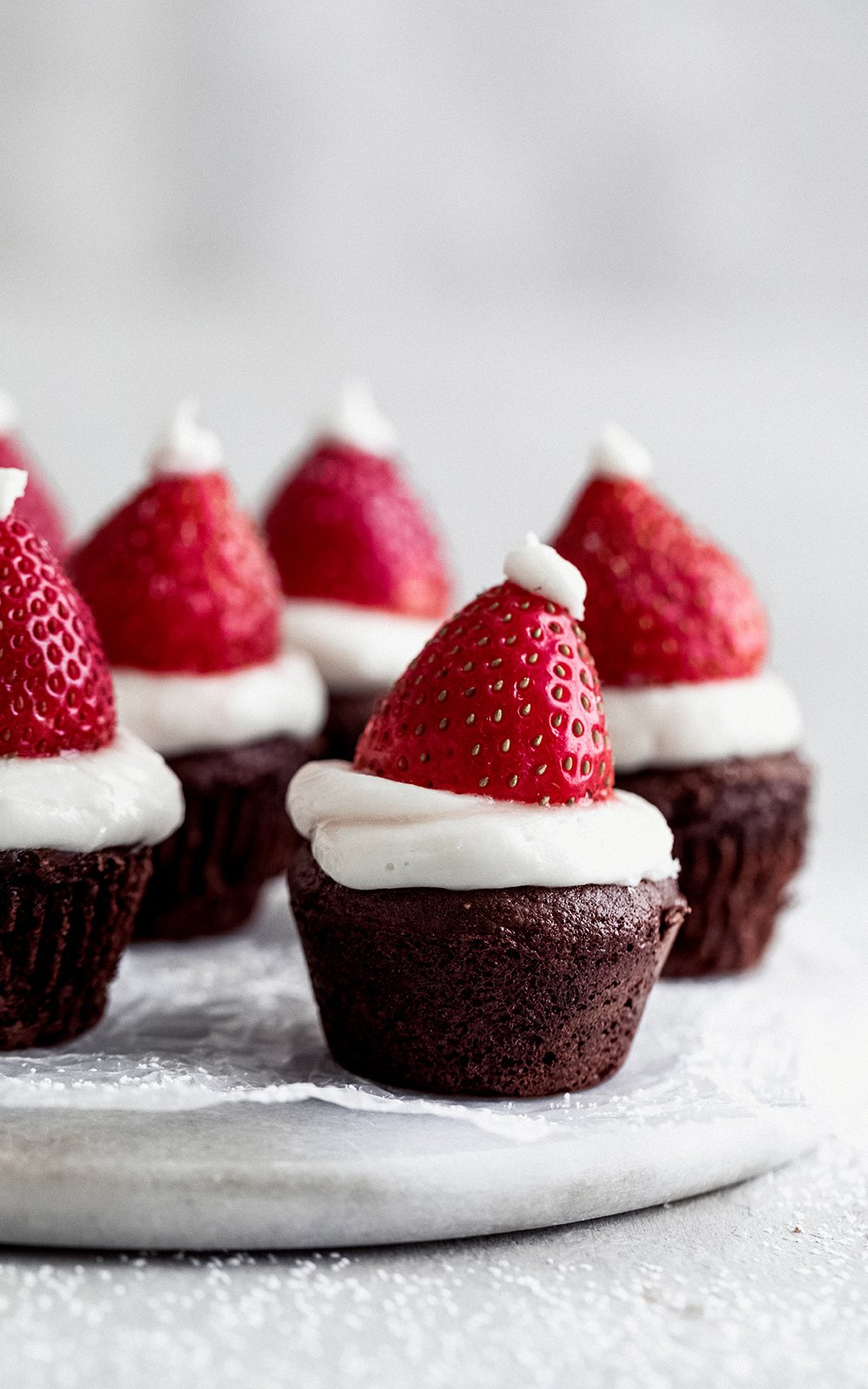 santa hat brownies on a marble board