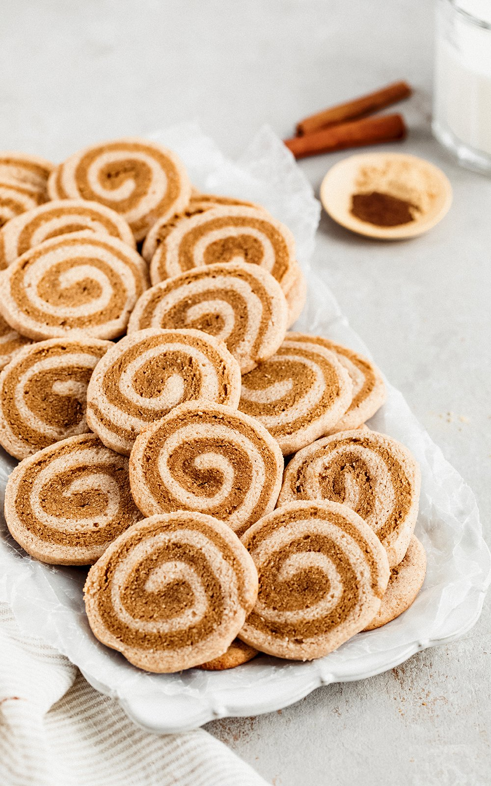 The cutest grain free gingerdoodle cookies make with a swirl of snickerdoodle cookie dough and gingerbread cookie dough. These festive cookies are perfectly sweet, gluten free, and great for the holidays!
