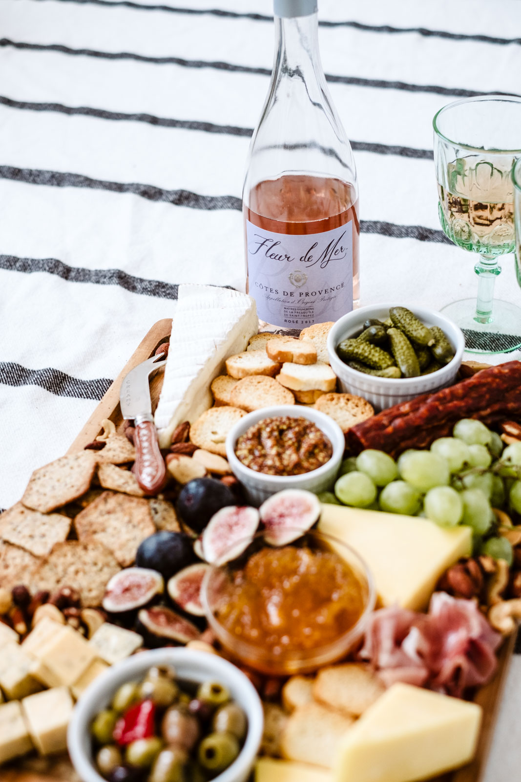 How to make a charcuterie board two different ways! These easy, beautiful charcuterie boards have a meat & cheese focus and a vegan option, and are perfect for the holidays. With a few quick tips and tools you can easily customize them!