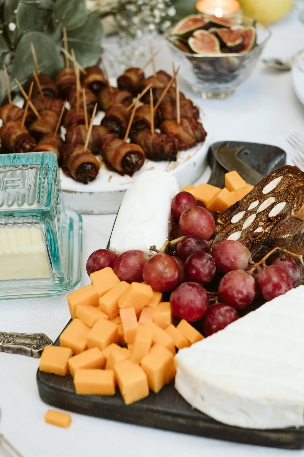 cheese and grapes on a charcuterie board