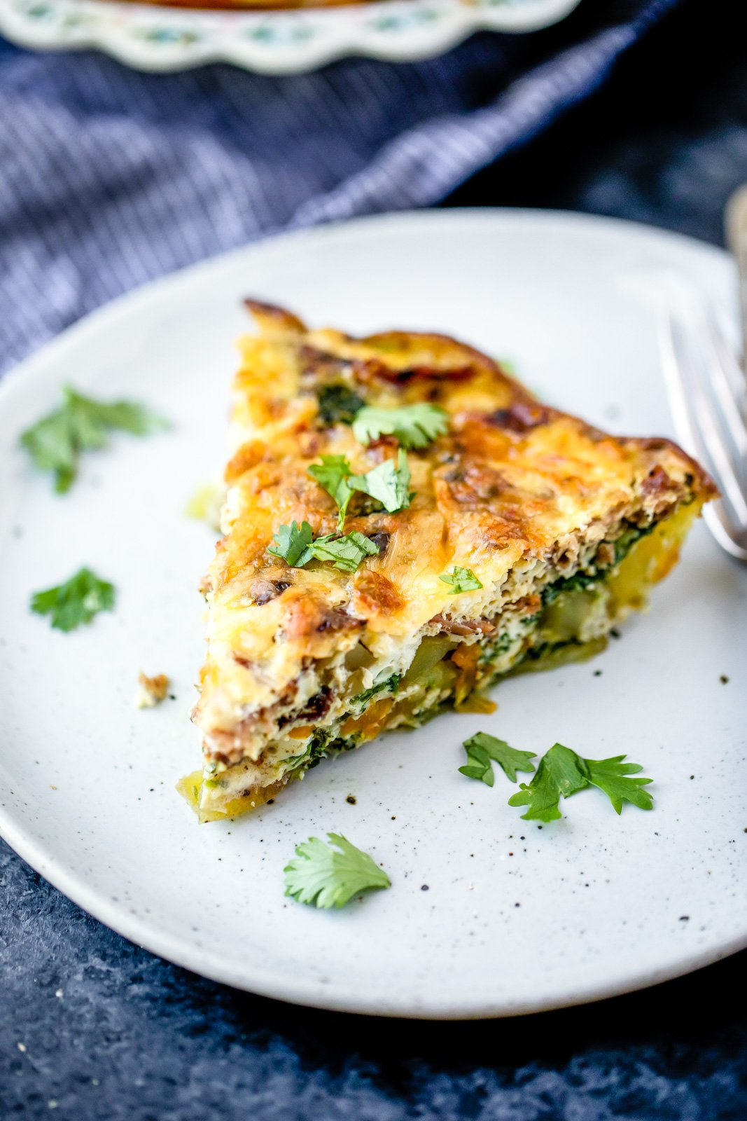 slice of low carb turkey bacon quiche on a plate