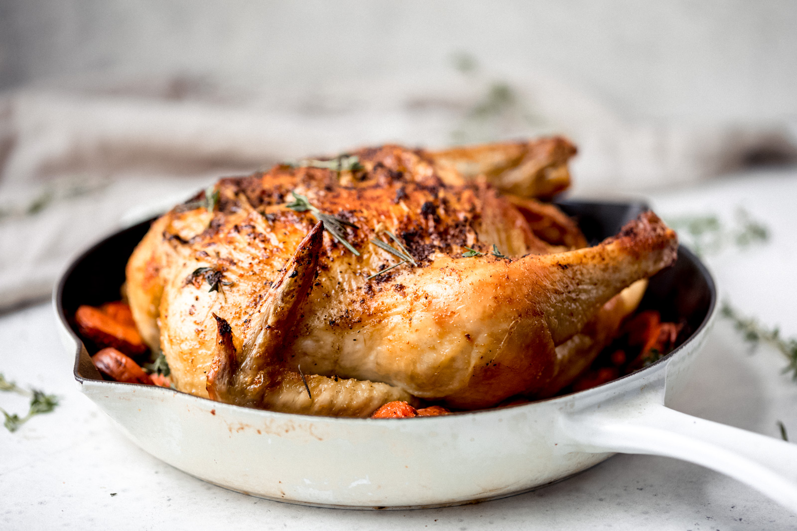 Learn how to make a delicious and easy whole roasted chicken. You just a need a few ingredients, a good roasting pan or skillet and a little over an hour! Makes juicy meat that's perfectfor serving as is or shredding and adding to soups, stews, enchiladas or tacos! Yum.