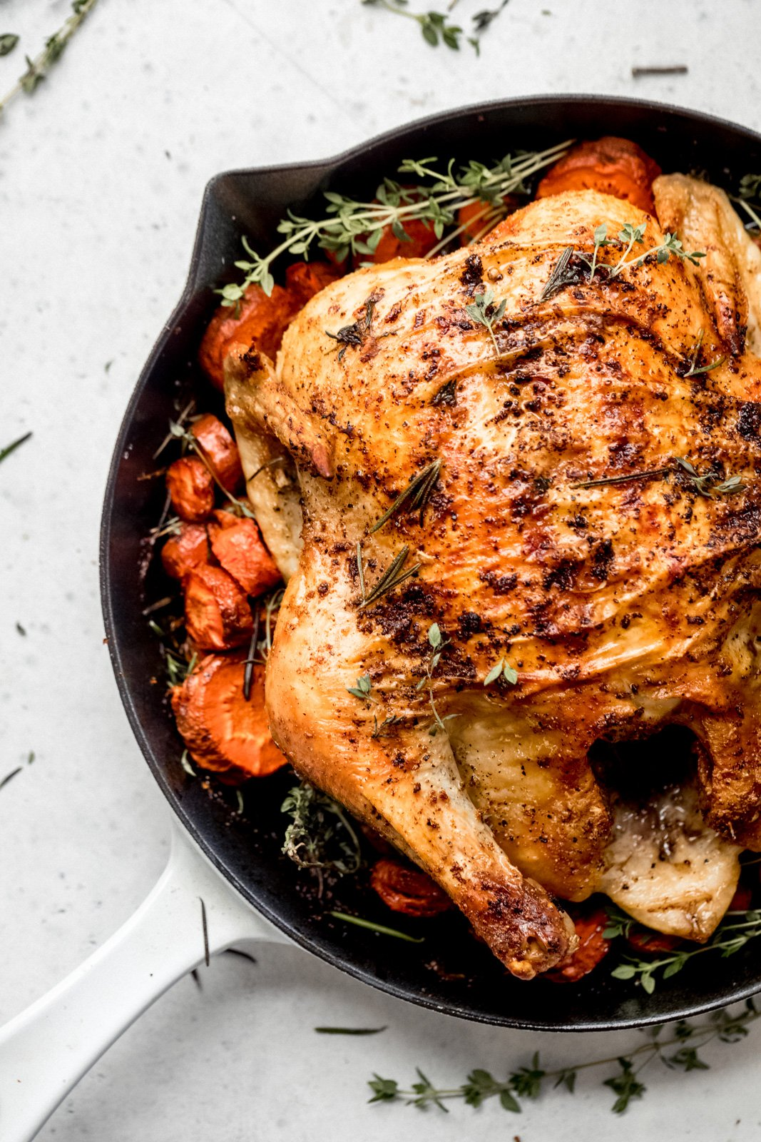whole roasted chicken in a skillet
