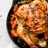 Learn how to make a delicious and easy whole roasted chicken. You just a need a few ingredients, a good roasting pan or skillet and a little over an hour! Makes juicy meat that's perfect for serving as is or shredding and adding to soups, stews, enchiladas or tacos! Yum.