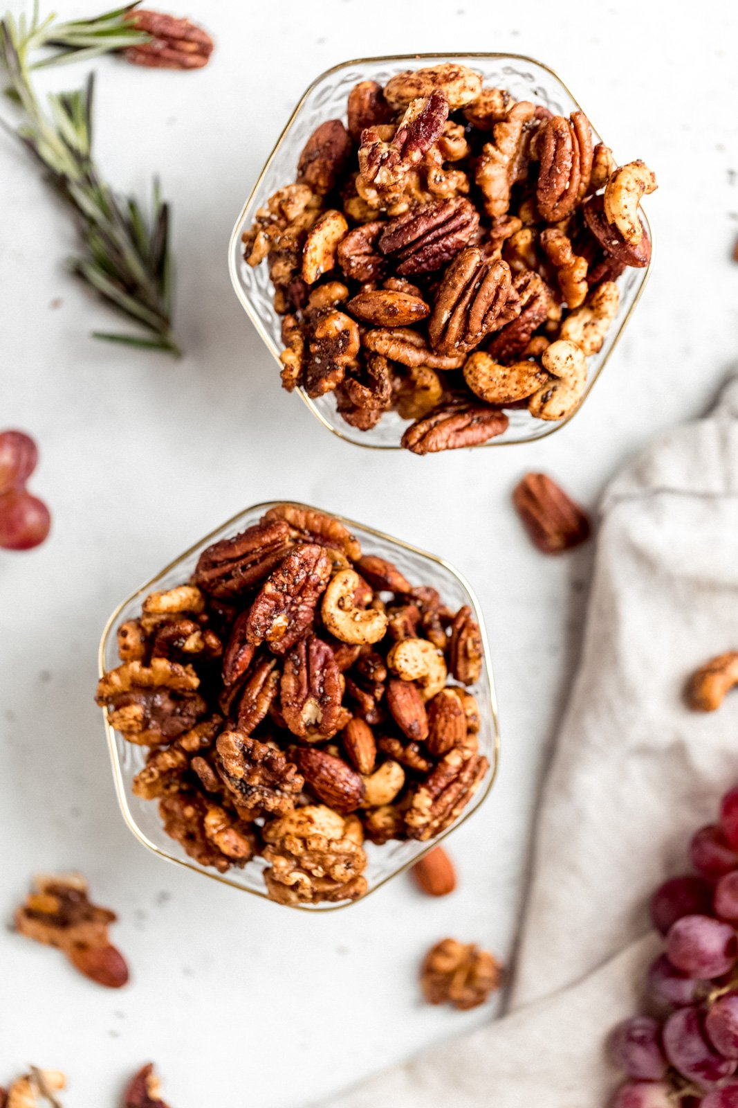 sweet and spicy nuts in two glass dishes