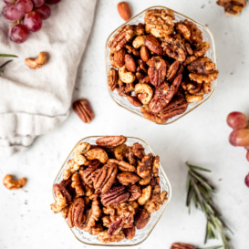 sweet and spicy nuts in two glass bowls
