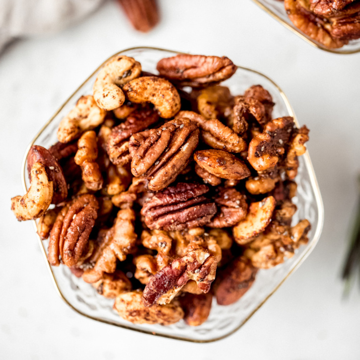 sweet and spicy nut mix in a glass bowl