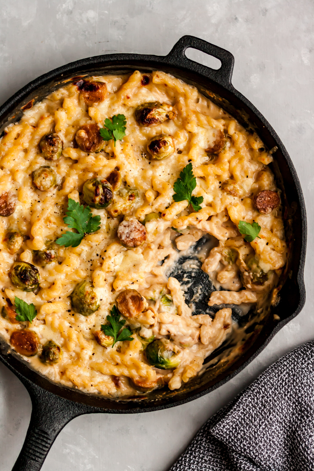 mac and cheese with brussels sprouts in a skillet