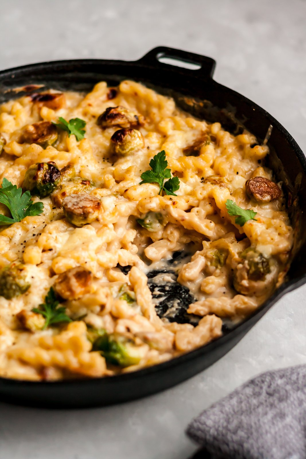 brussels sprouts mac and cheese in a skillet pan